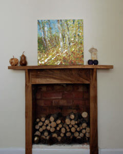 trees in golden light acrylic painting on fireplace
