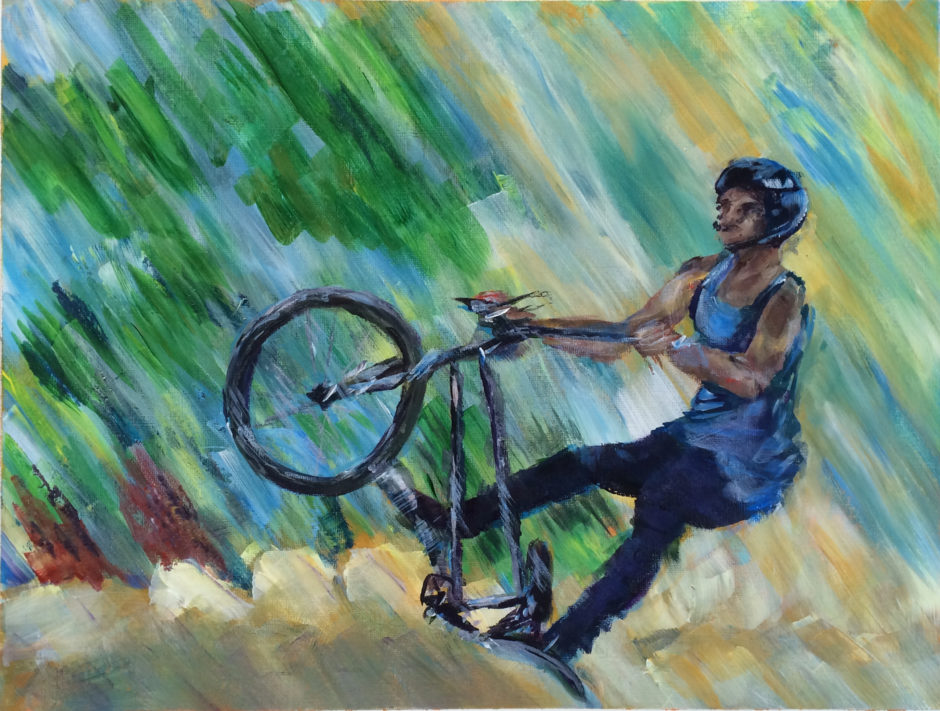 acrylic printing of a stunt cyclist taking off