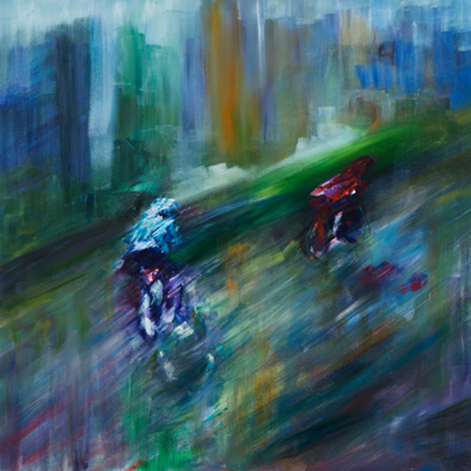 two cyclists in rain in city in Tour de France UK 2013